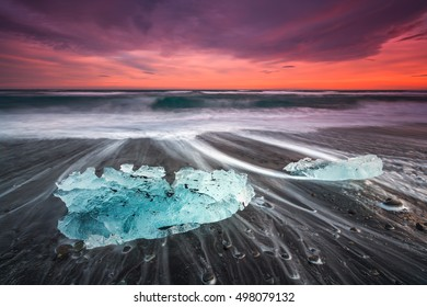 Ice on the black volcanic beach near Jokulsarlon glacier lagoon, winter Iceland