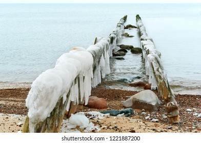 ice on breakwaters in the sea, breakwaters covered with ice