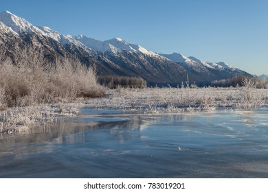 Ice overflow along the Chilkat River in Southeast Alaska on a sunny winter day.