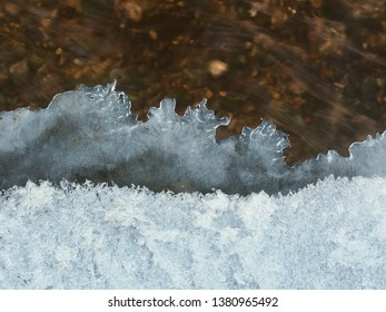 Ice patterns formed along a creek