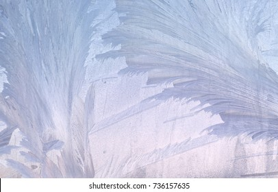 Ice patterns on winter glass. Christmas frozen background. Winter toning effect.