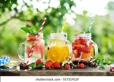 Ice refreshing summer drinks on blurred background.