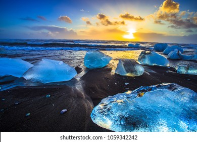Ice rock with black sand beach at Jokulsarlon beach (Diamond beach) in southeast Iceland