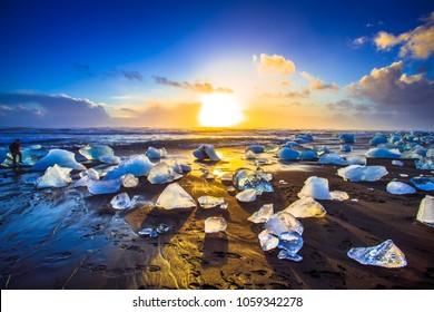 Ice rock with black sand beach at Jokulsarlon beach (Diamond beach) in southeast Iceland