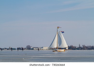 Ice sailing in a historic icesailboat on the Braassem lake in the Netherlands.