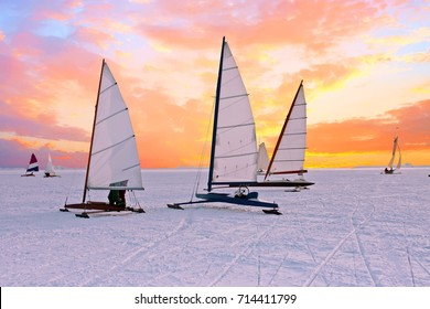 Ice sailing on the Gouwzee in the countryside from the Netherlands at sunset