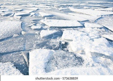 the ice sheets of an icebound lake, winter