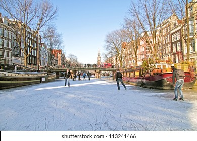 Ice skating on the canals in Amsterdam the Netherlands in winter