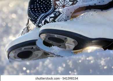 Ice skating is a popular winter sports. Ice skates in the snow