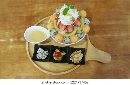 Ice smoothie served with various fruits called Bingsu.