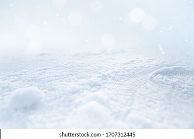 ICE AND SNOW BACKGROUND ON LIGHT BLUE BOKEH LIGHTS, COLD WINTER OR CHRISTMAS BACKDROP FOR MONTAGE PRESENTS OR FRESH PRODUCTS