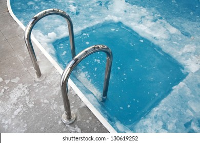 Ice swimming theme. Steps in the frozen blue pool ice-hole