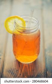 Ice tea in a mason jar up close - split toned