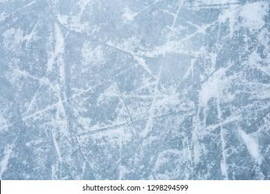 Ice texture. Winter background. Ice skating tracks. Hockey