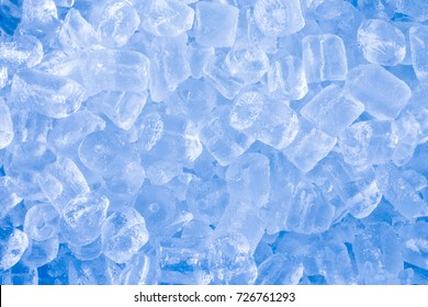 A lot of ice tube on light blue background.