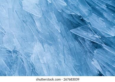 Ice washed up on lake shore like shards of glass, Lofoten, Norway