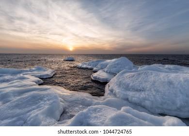 Ice winter in the Baltic Sea. Ice blocks on the shore of the Gulf of Finland, Estonia.