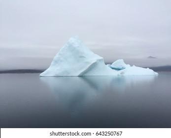 Iceberg along the eastern Baffin Island coastline near the community of Qikiqtarjuaq, Nunavut Canada