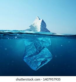 Iceberg with bottle in the ocean underwater. Environmental pollution. Plastic water bottles pollute ocean.