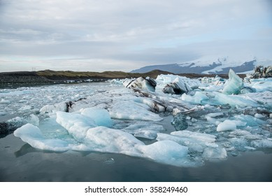 Iceberg in Jokulsarlon glacier lagoon melting from the Vatnajokull (the biggest glacier in Europe), beautiful nature landscape in winter season of Iceland, Global warming and Climate change effect
