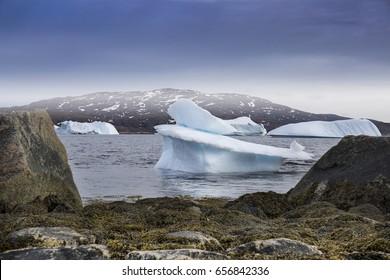 Iceberg on sea with beautiful stone, nature of north world qaqortoq greenland