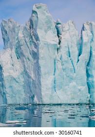 Iceberg on Spitsbergen island reflecting in water