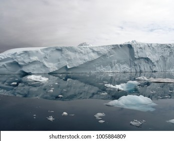 Iceberg reflection on a cloudy day in Disko Bay, Greenland, Arrow shaped pattern