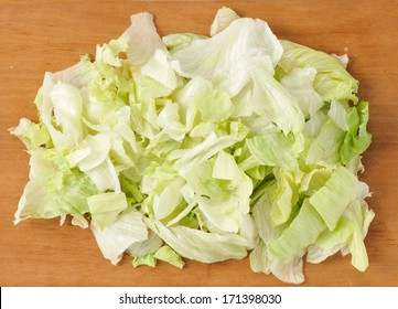 Iceberg salad on wooden board