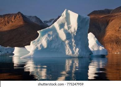 An Iceberg slowly melting in Scoresbysund on the east coast of Greenland.