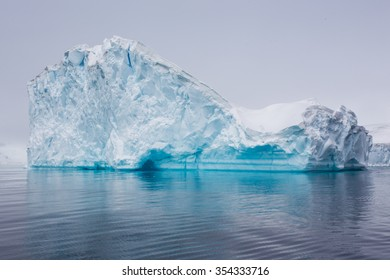 An Iceberg that has broken off a glacier floating along the gentle Antarctic waters