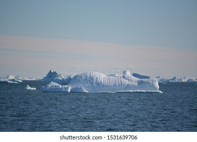 icebergs in the arctic sea from the Eqip Sermia - Eqi Glacier in Greenland. Boat trip in the Disko Bay. World heritage -  extremly affected by global warming and climate change. Summer - July