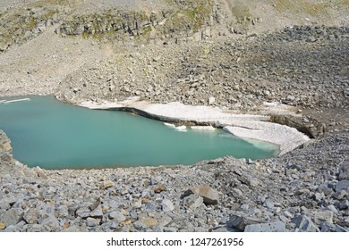 Icebergs broken off from a glacier in a glacial lake in the mountains as the climate warms.