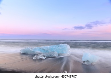 icebergs at crystal black beach in south Iceland