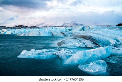 Icebergs drifting to sea in Jokulsarlon during Winter. Jokulsarlon - Iceland