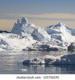 Icebergs of fantastic forms. Summer in Greenland. Deep-water fjords of the Western coast.