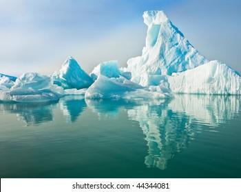 Icebergs floating in calm water.  Horizontally framed shot.
