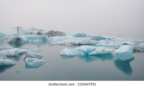 Icebergs floating in Jokulsarlon glacial lagoon in Iceland. Nature, holidays, travel concept