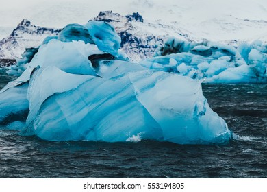 Icebergs floating in Jokulsarlon glacial lagoon. Vatnajokull National Park, southeast Iceland, Europe.