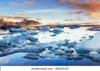 Icebergs floating in Jokulsarlon glacial lake in the west. South Iceland. Lagoon to the west.