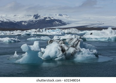 Icebergs floating in Jokulsarlon Glacier Lagoon in Iceland during beautiful sunny late afternoon