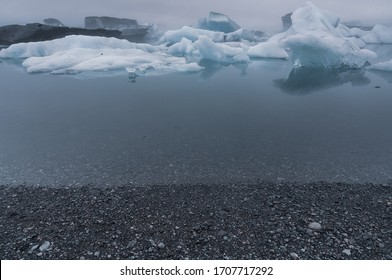 Icebergs floating on glacial lagoon lake, Iceland