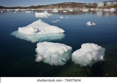 icebergs floating on the water of the sea in Ilulissat, Greenland. this ice is what left from the winter (when all the sea is frozen). global warming, the ice is melting
