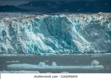 Icebergs in front of Columbia glacier under the clouds, Alaska