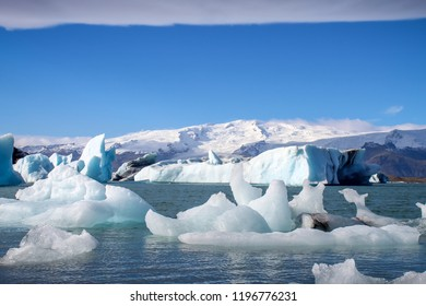 icebergs from Glacier floating in a lagoon in Iceland as a result of global warming