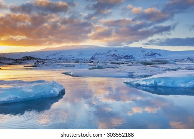 Icebergs in a glacier lake in Iceland in winter. Photographed at sunset.