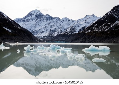 Icebergs from Hooker Glacier float in front of Mount Cook, the tallest mountain in New Zealand.