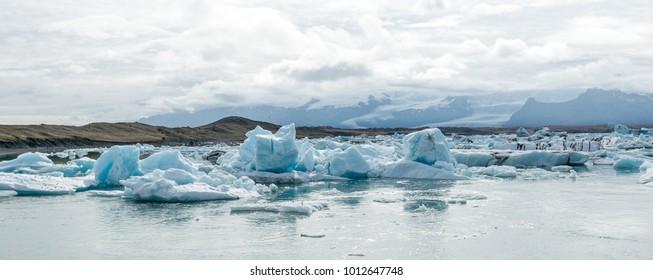 Icebergs in icelandic glacier lake Jokulsarlon, In the background you can see the Vatnajokull glacier.