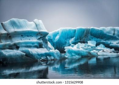 Icebergs in Jokulsarlon beautiful glacial lagoon in Iceland. Jokulsarlon is a famous travel destination in Vatnajokull National Park, southeast Iceland, Europe. Winter landscape.