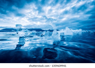 Icebergs in Jokulsarlon glacial lagoon. Vatnajokull National Park, southeast Iceland, Europe. Landscape photography. Tonned by blue filter