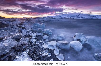 Icebergs in Jokulsarlon glacial lake during sunset, Iceland, Europe.